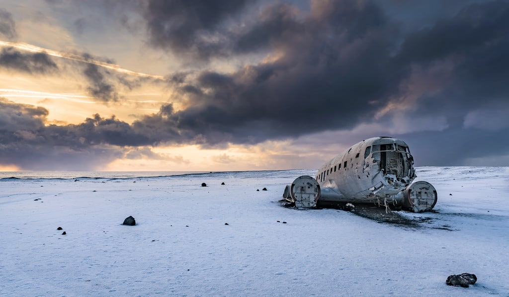 Image of Wrecked DC-3 Plane. winter sunset sun snow color k set photoshop plane landscape photography is photo iceland nice fantastic scenery colours angle image south 14 wide creative remix free commons lenny cc commercial elements use land wreck scape non dc3 toolkit edit actions noncommercial distribute sólheimasandur batis225 lennykphotography