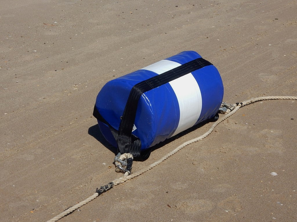 Image of Grange Beach near Grange. sand rope beach bag grange float