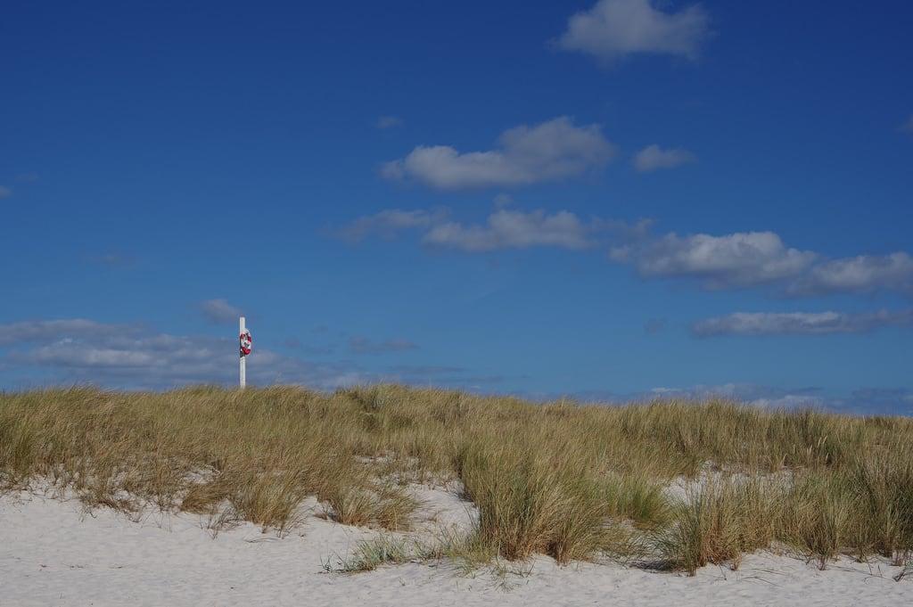 Image of Sandy beach. pentaxda18135f35wr life buoy bornholm dueodde denmark beach