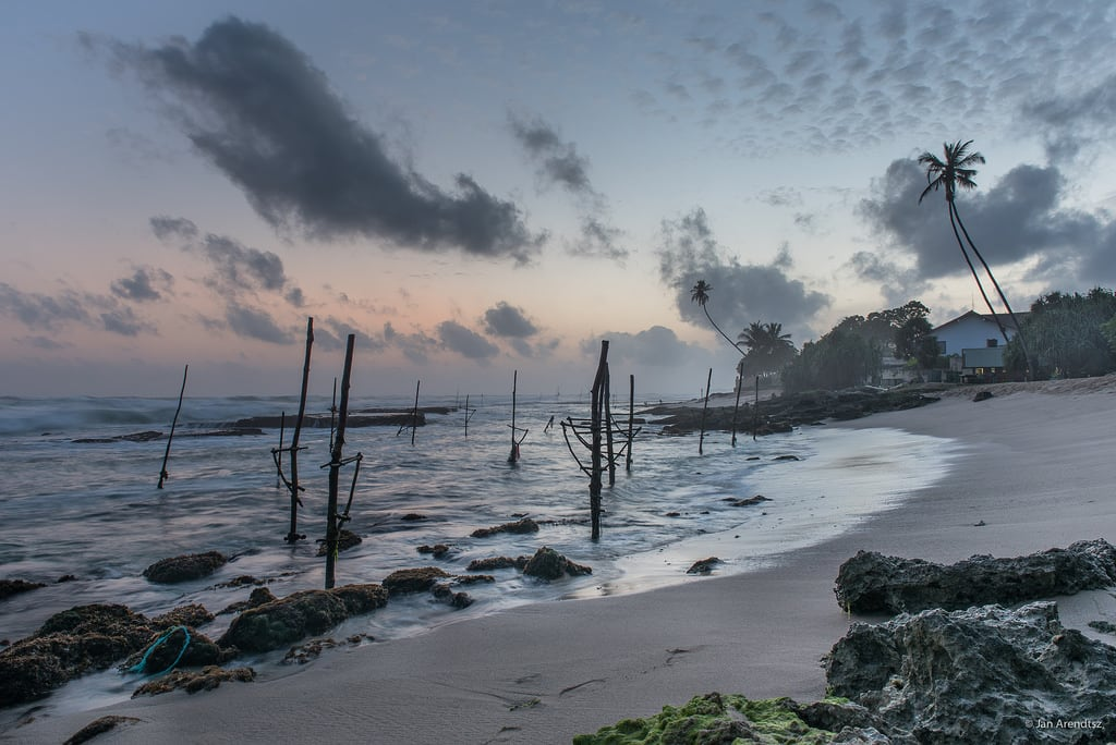 Image of Koggala Beach Beach with a length of 3054 meters. asia beach clouds coconuttree coconuttrees dusk fishing galledistrict island koggala landscape nature rock sand sky southasia southernprovince srilanka stiltfishing sunset tree tropical twilight weather lk