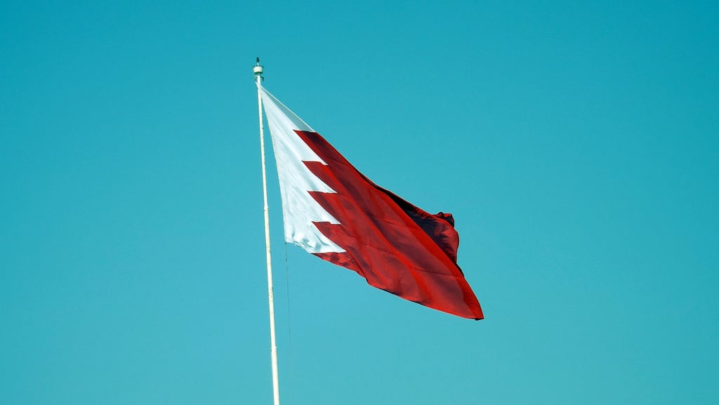 Image of Arad Fort. bahrain flag manama arad fort sky contrast